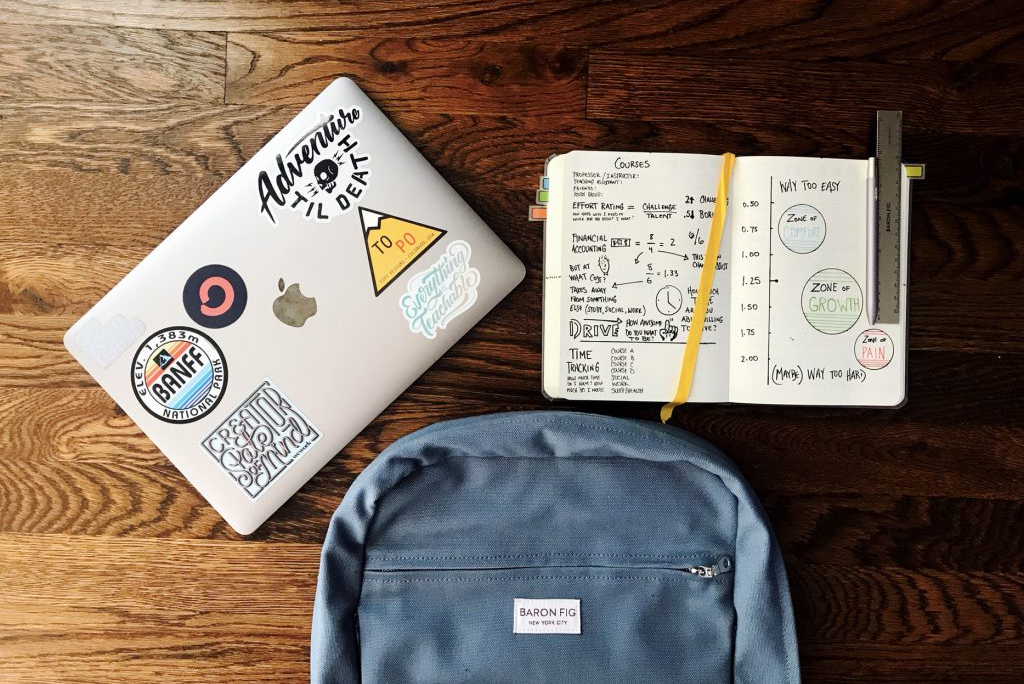 laptop notebook and bookbag on a table